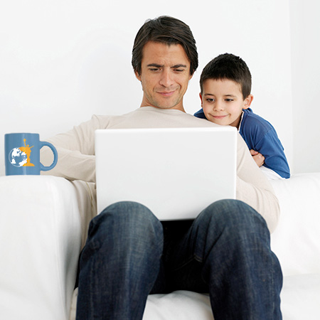 Student working on assignments on laptop with child
